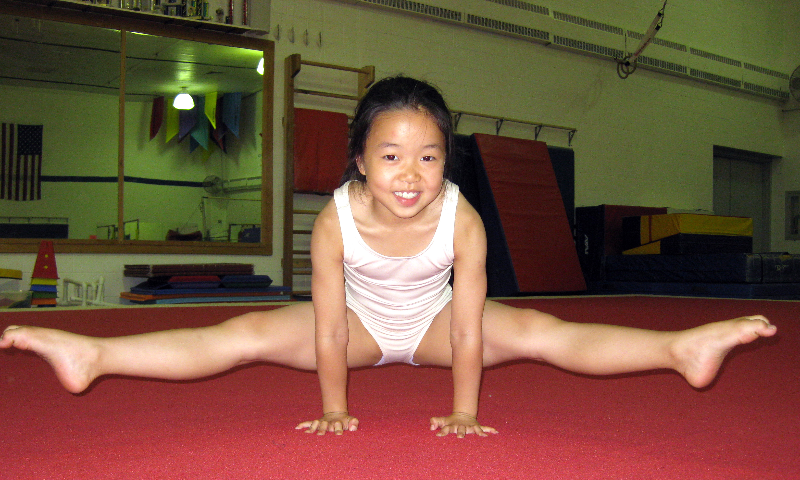 Young little girls gymnastics legs spread