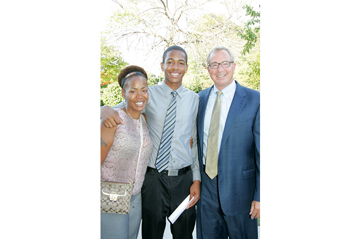 Victoria and son Jajuan with Dick Malone, president and CEO of YMCA of Metro Chicago