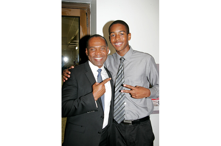 Ken Bennett, First Deputy Chief of Staff and and director of the Mayor's Office of Public Engagement, with Jajuan Roberson, YMCA youth participant